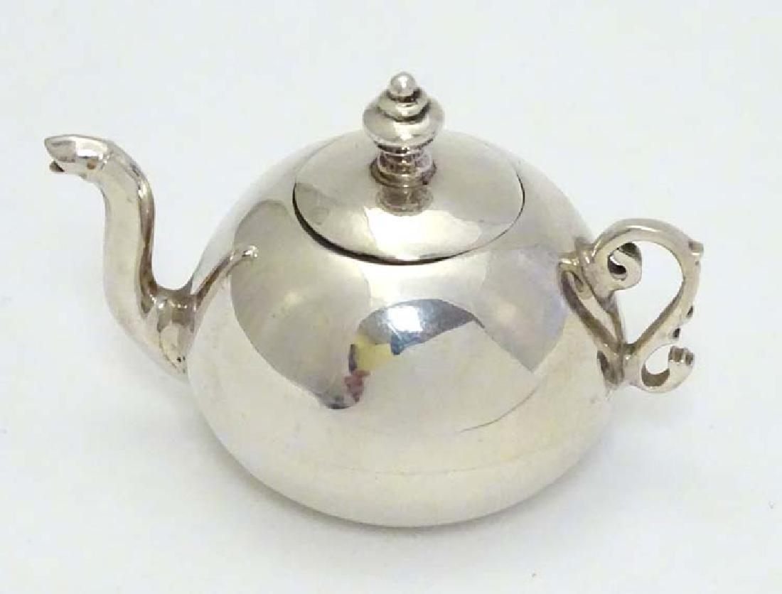 A .925 silver miniature model of a teapot 1 1/2'' high - 4