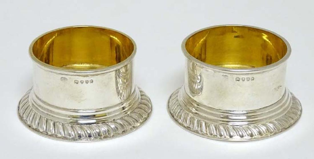 A pair of silver circular salts with gadrooned base and