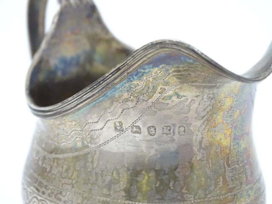 A Geo IIl silver cream jug with engraved decoration and - 4