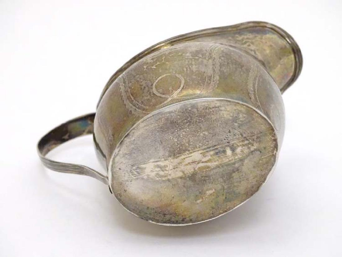 A Geo IIl silver cream jug with engraved decoration and - 7