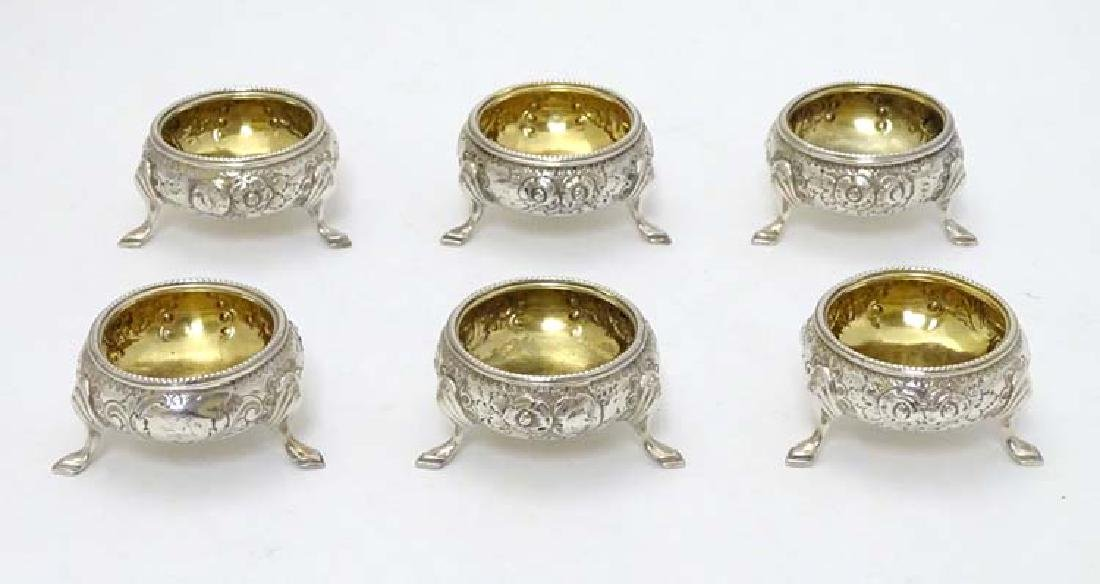 A set of 6 silver salts of circular form with floral