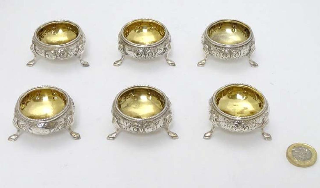 A set of 6 silver salts of circular form with floral - 3