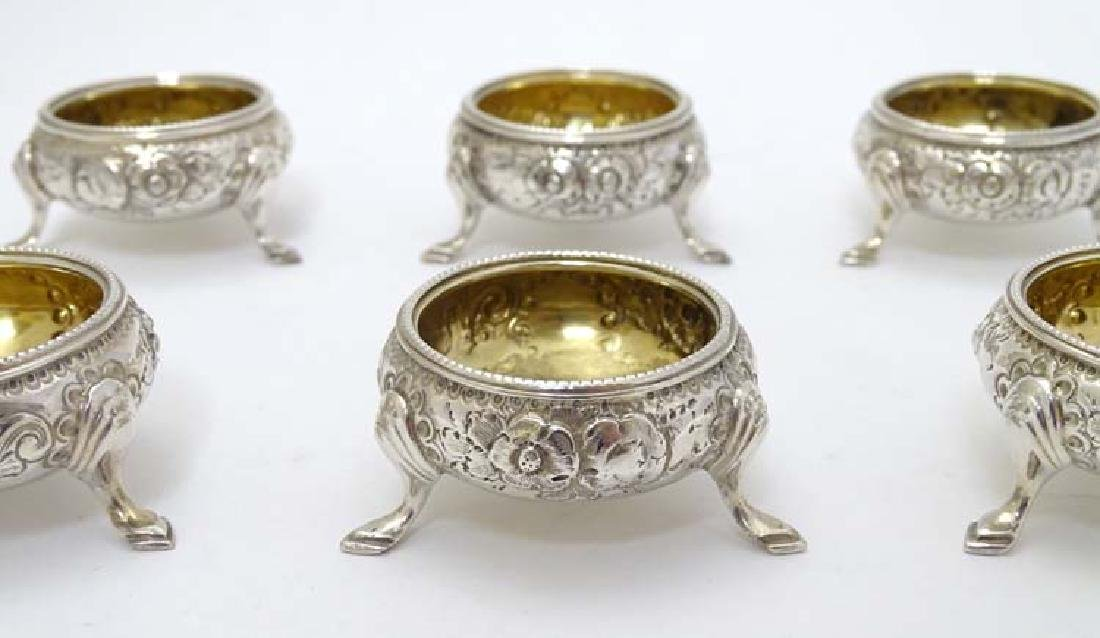 A set of 6 silver salts of circular form with floral - 4