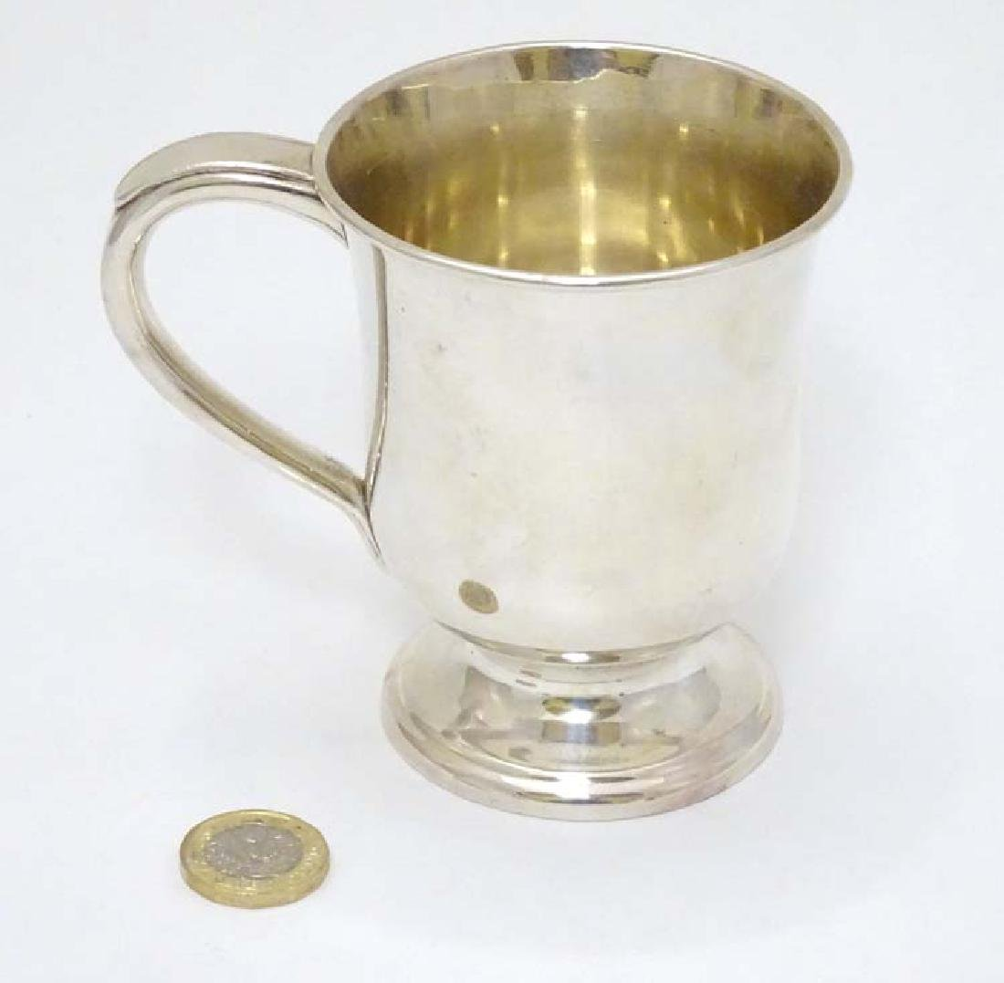 A silver plate tankard with loop handle 4'' high