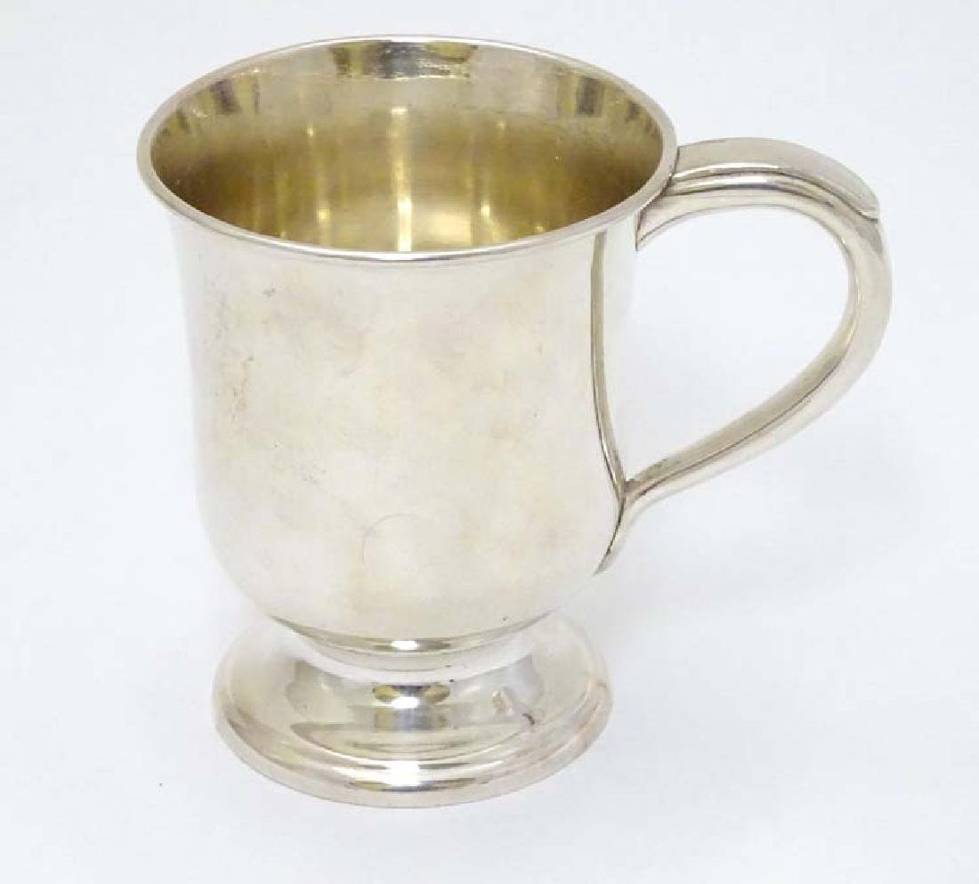 A silver plate tankard with loop handle 4'' high - 4