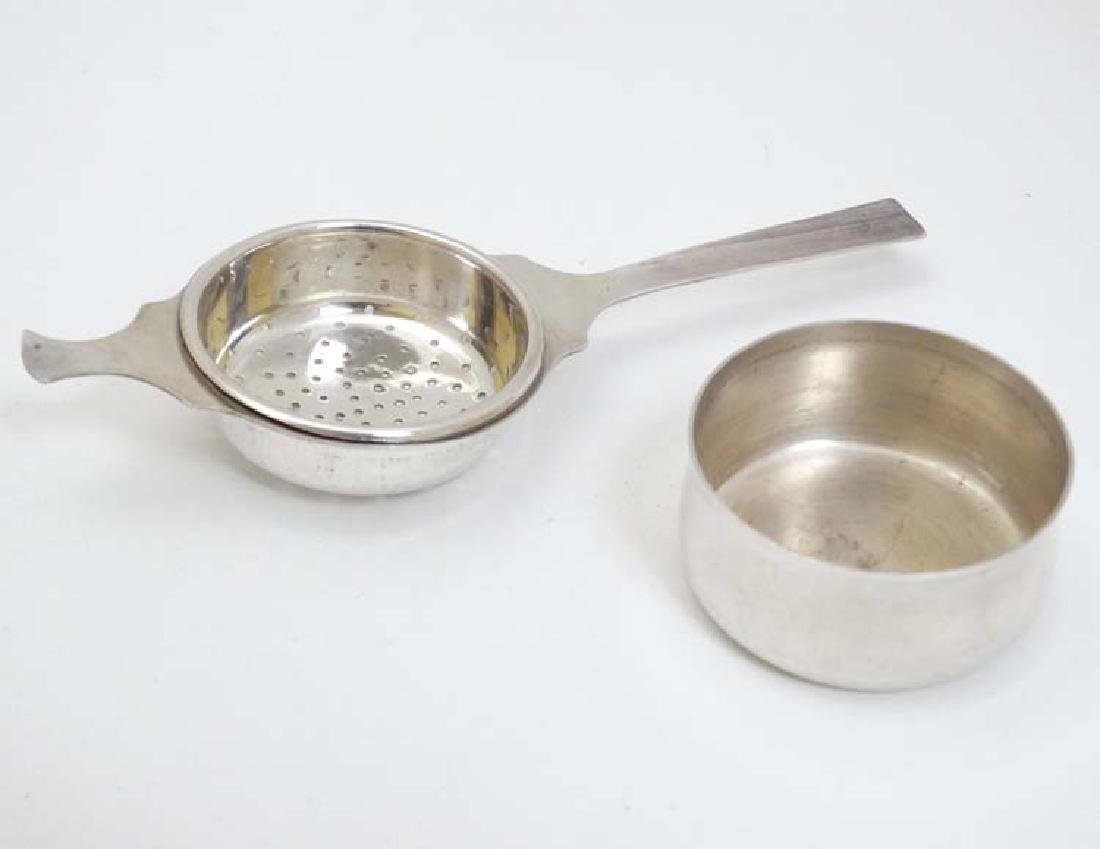 A silver plate tea strainer with stand. 6'' long - 3