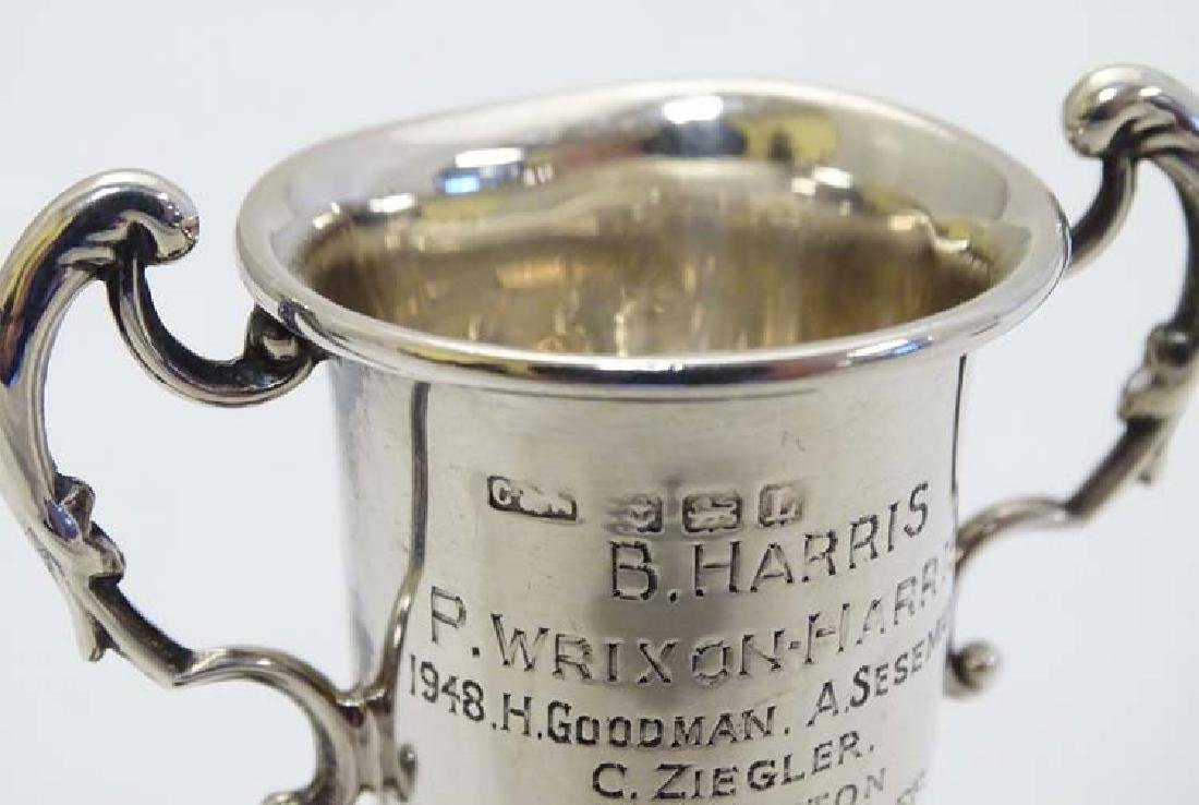 A miniature twin handled trophy cup mounted on a turned - 4