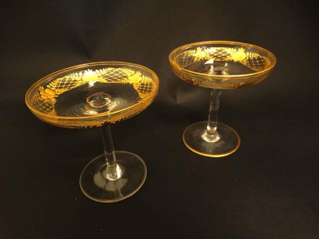 Glass : a pair of Art Deco champagne saucers with gilt