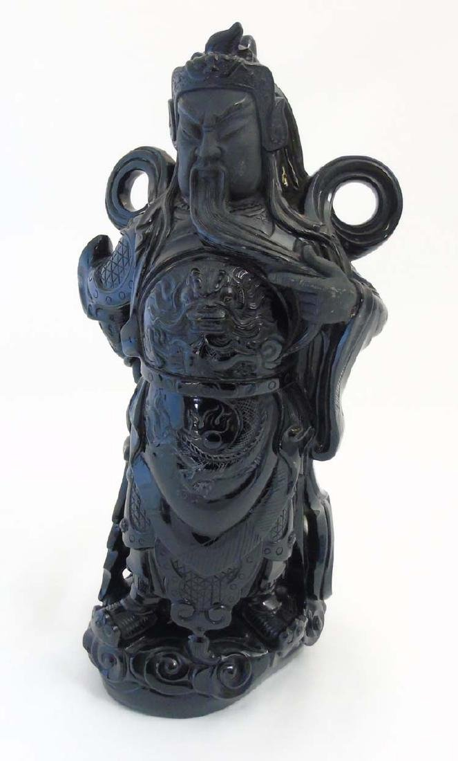 A Chinese carved polished black hard stone figure of - 3