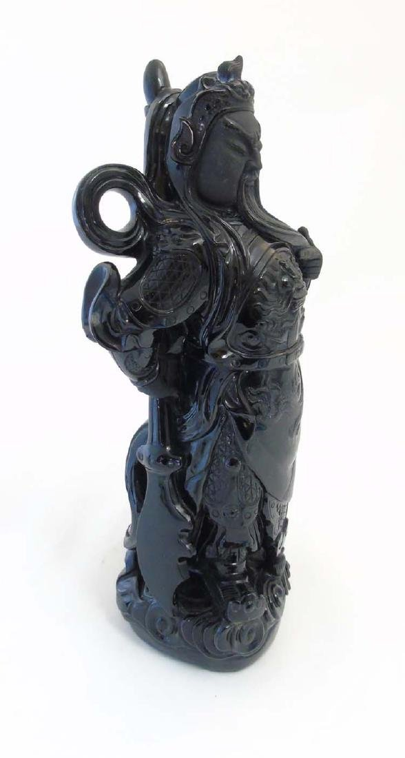 A Chinese carved polished black hard stone figure of - 4