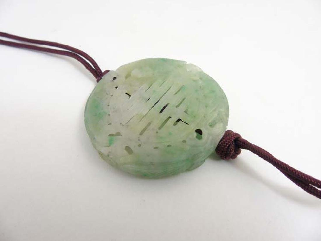 A Chinese pendant of green flecked jadeite / nephrite, - 5