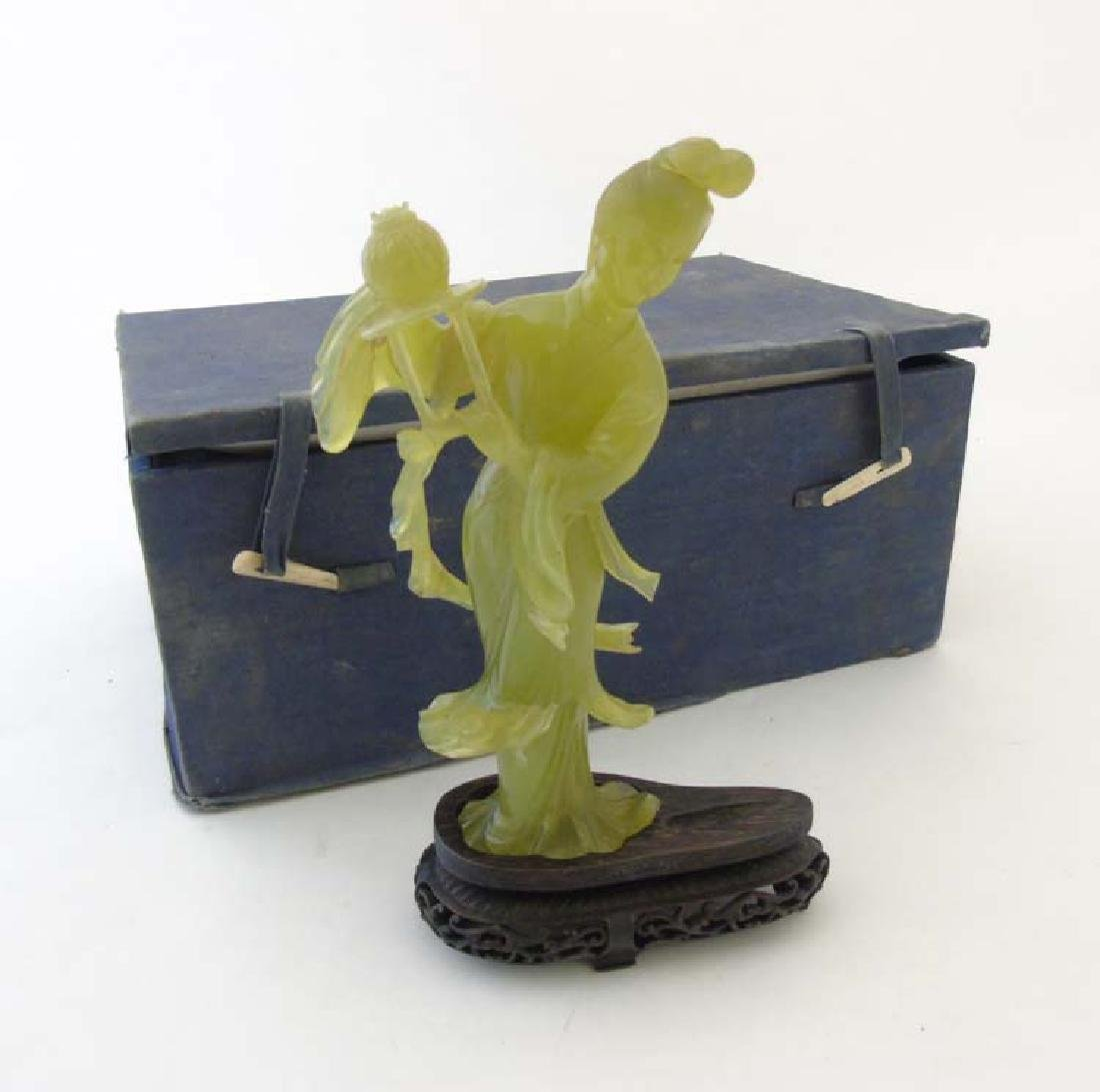 A Chinese jade / jadeite figure and stand, 9 3/4'' high