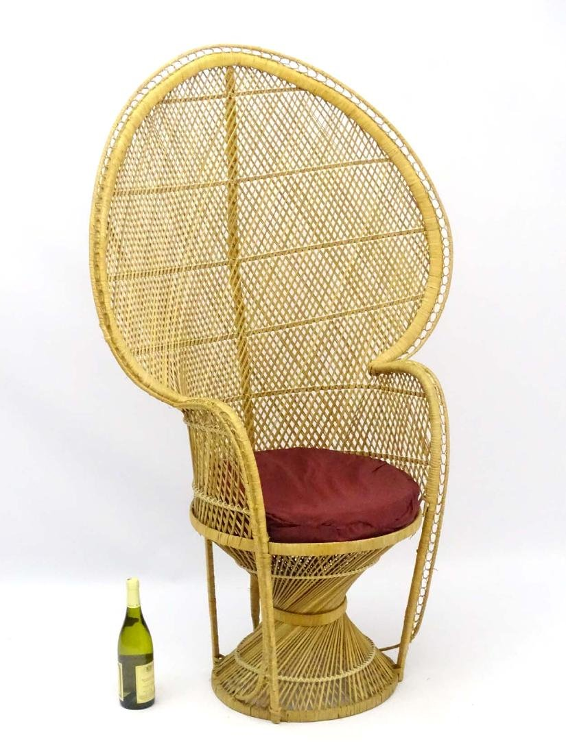 A late 20thC wicker and rattan peacock chair. 57'' high