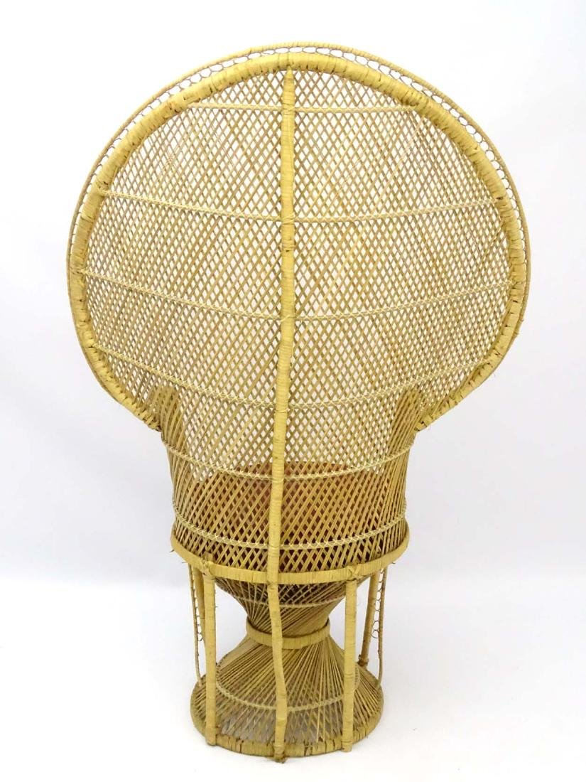 A late 20thC wicker and rattan peacock chair. 57'' high - 2