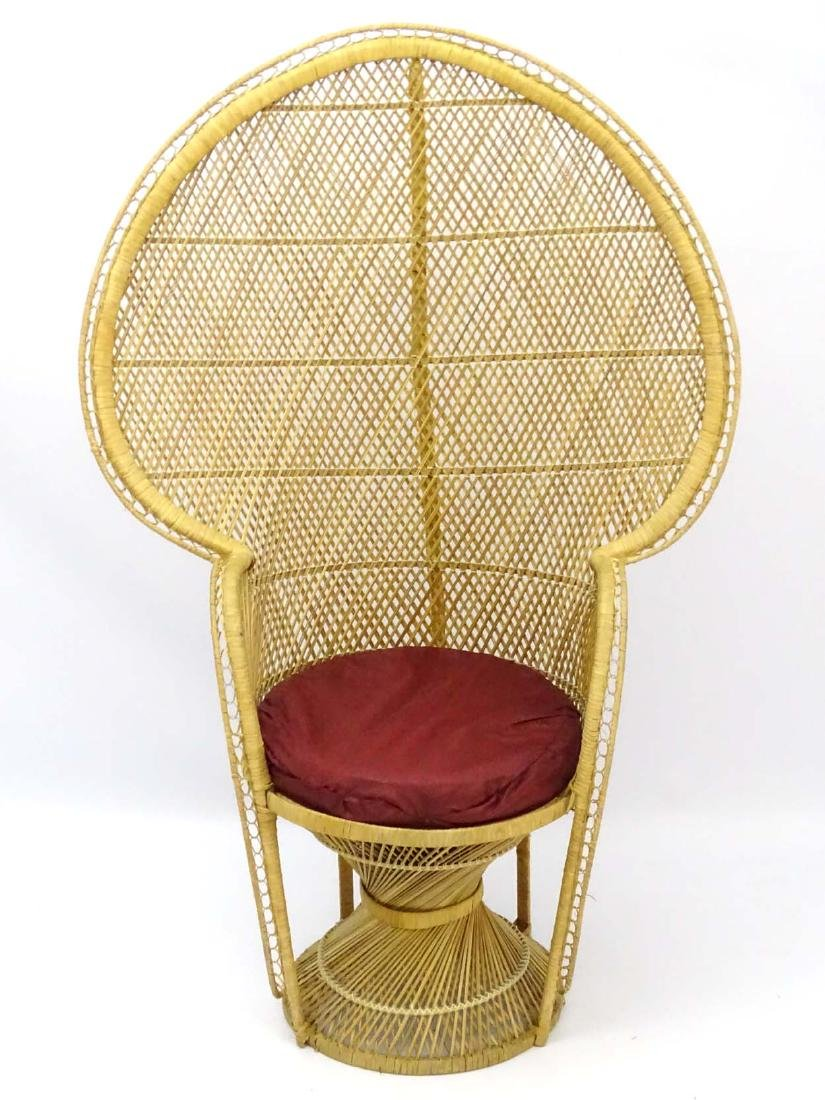 A late 20thC wicker and rattan peacock chair. 57'' high - 3