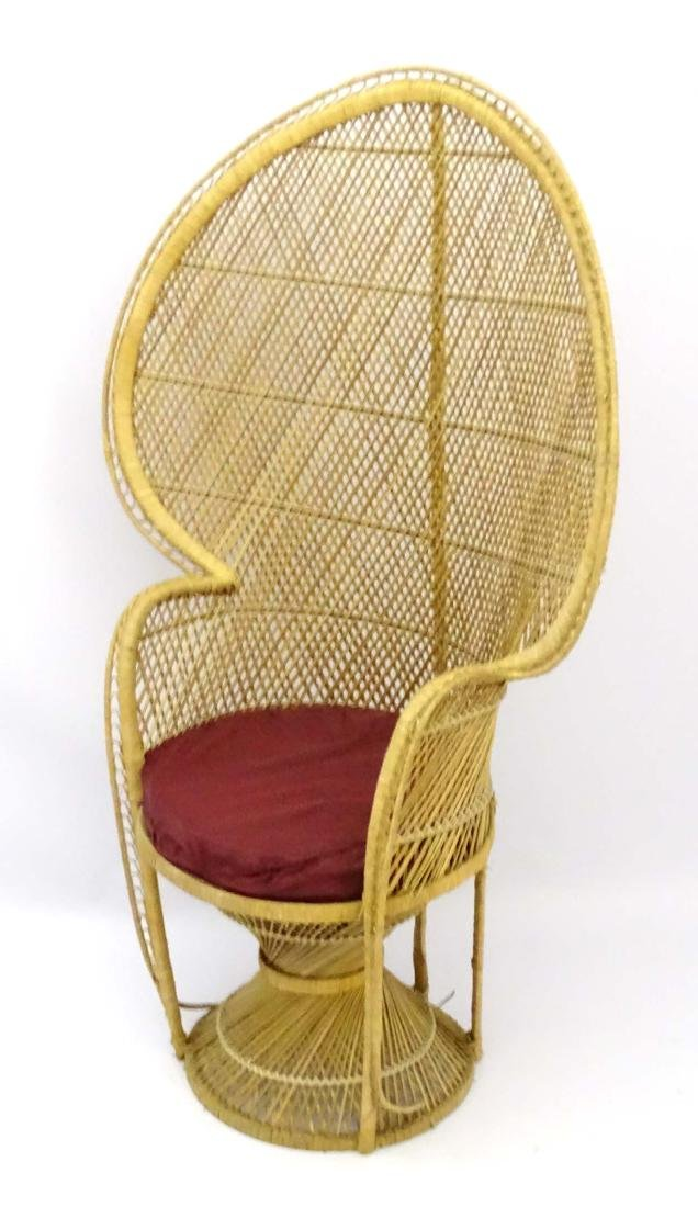 A late 20thC wicker and rattan peacock chair. 57'' high - 4