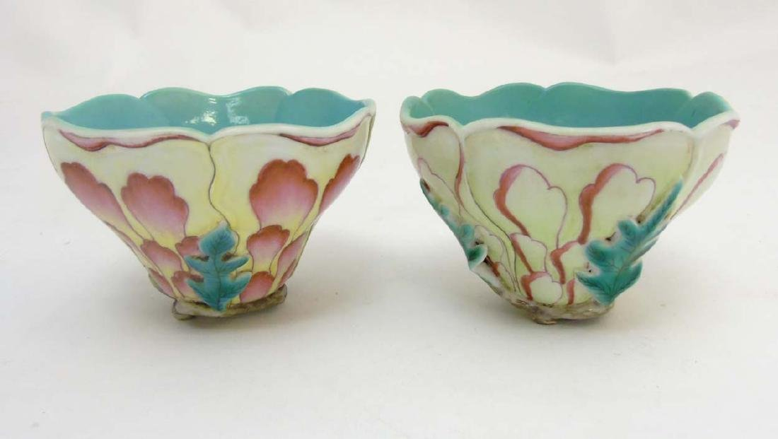 A pair of Chinese moulded flower cups formed as