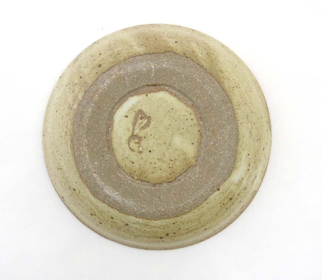 A studio pottery bowl of beige tones decorated with - 2