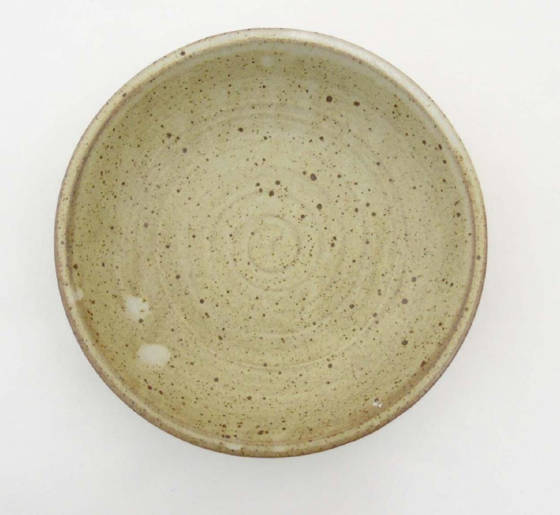 A studio pottery bowl of beige tones decorated with - 5