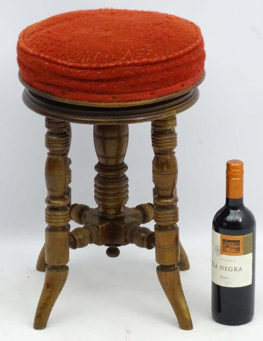A Victorian mahogany piano stool standing on ring