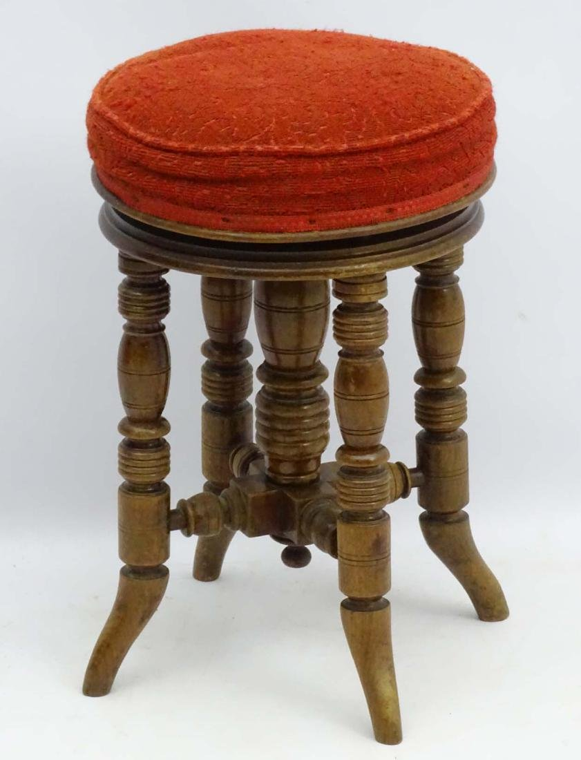 A Victorian mahogany piano stool standing on ring - 2
