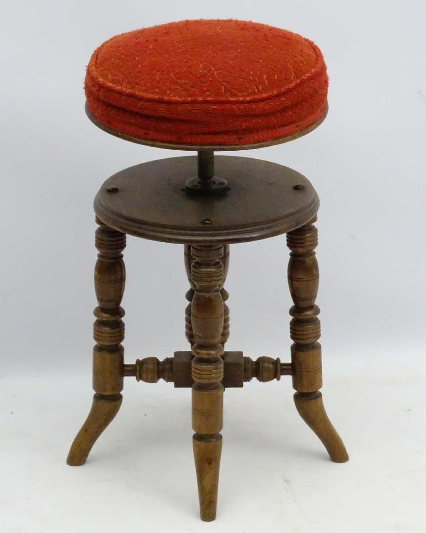 A Victorian mahogany piano stool standing on ring - 3