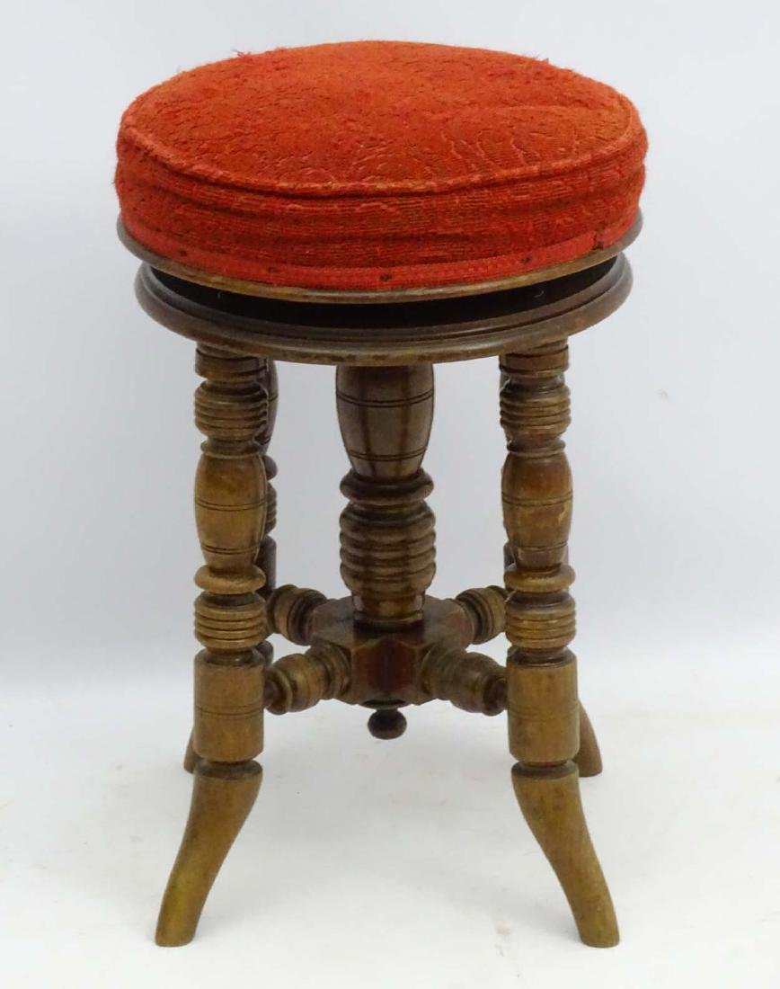 A Victorian mahogany piano stool standing on ring - 4