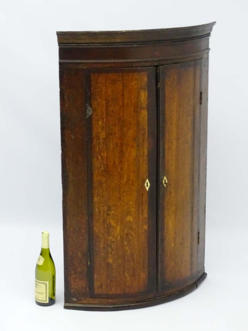 A late 18thC oak bow fronted corner cupboard with - 3