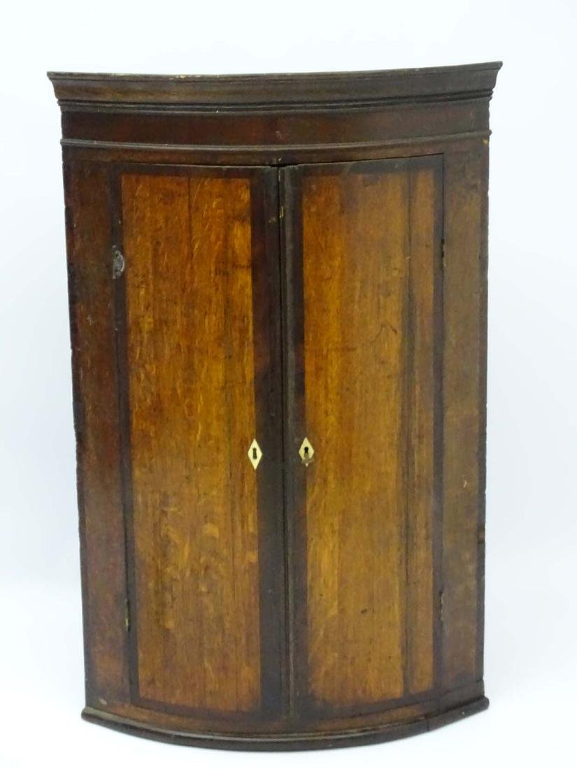 A late 18thC oak bow fronted corner cupboard with - 4