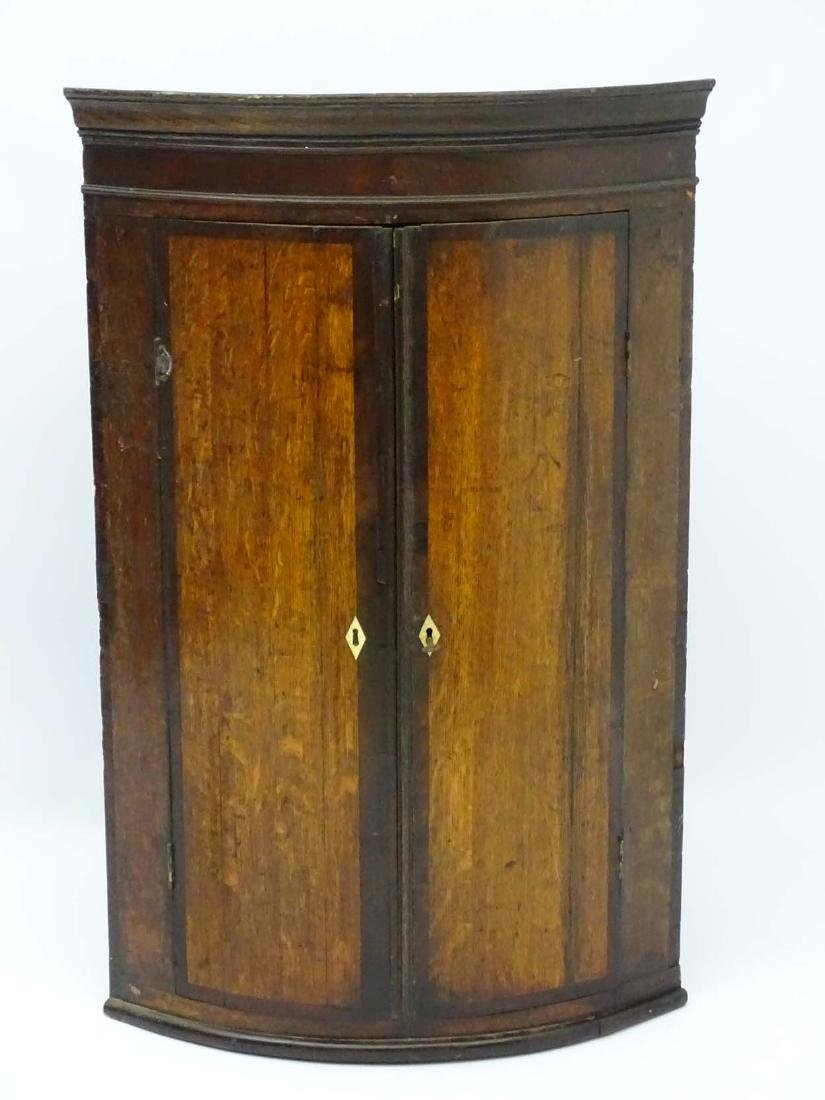 A late 18thC oak bow fronted corner cupboard with - 5