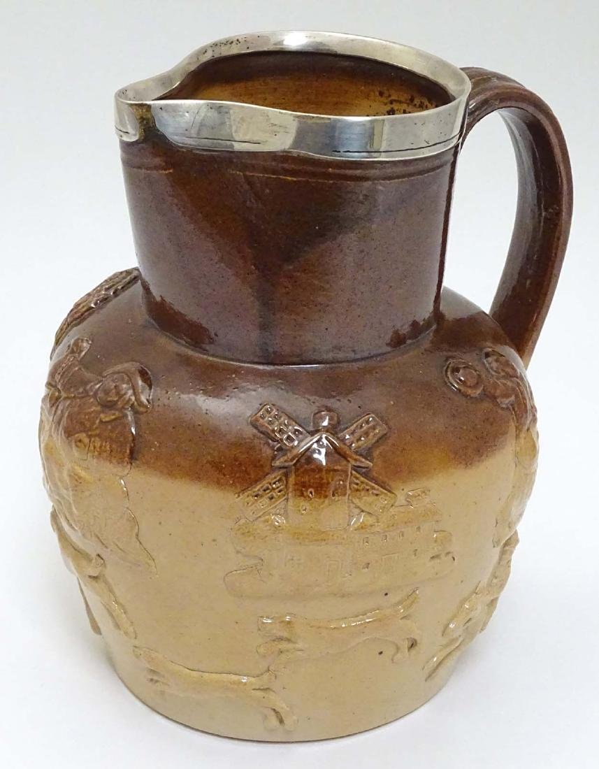 A Victorian stoneware salt glazed hunting jug with