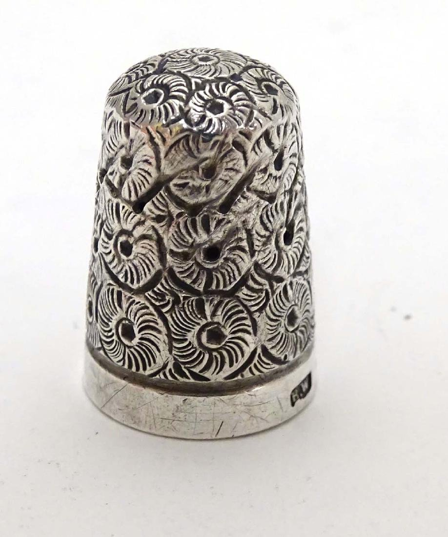 A Victorian  silver thimble hallmarked 1896 maker