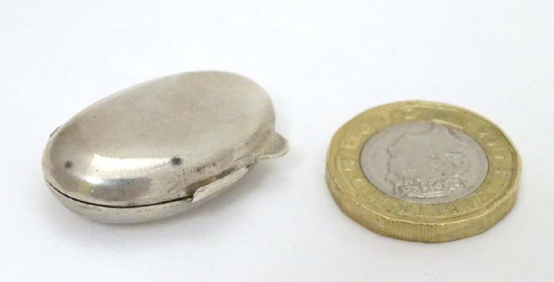A Continental .800 silver small pill box of ovoid form
