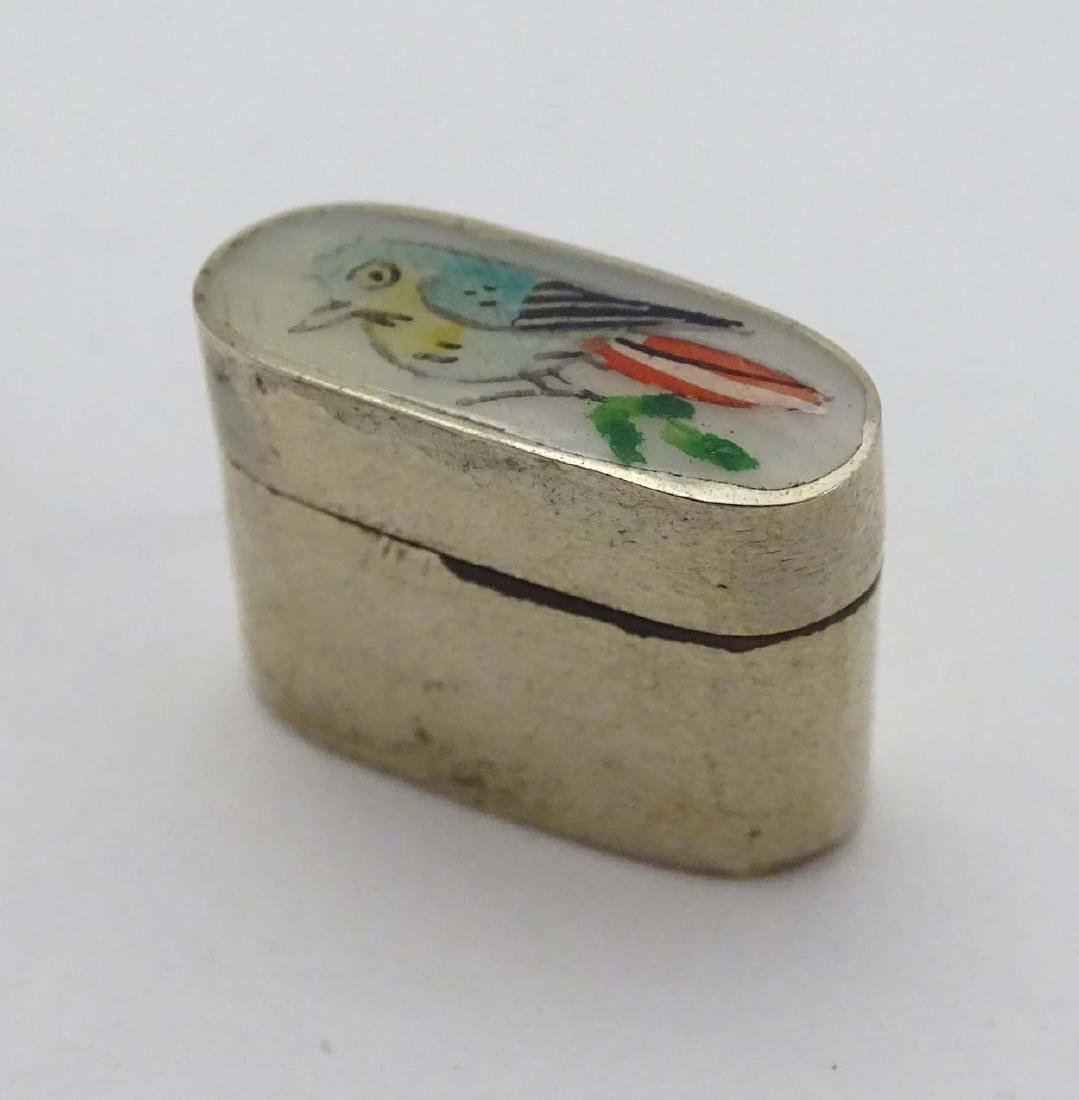 A silver plate small pill box of ovoid form with image - 2