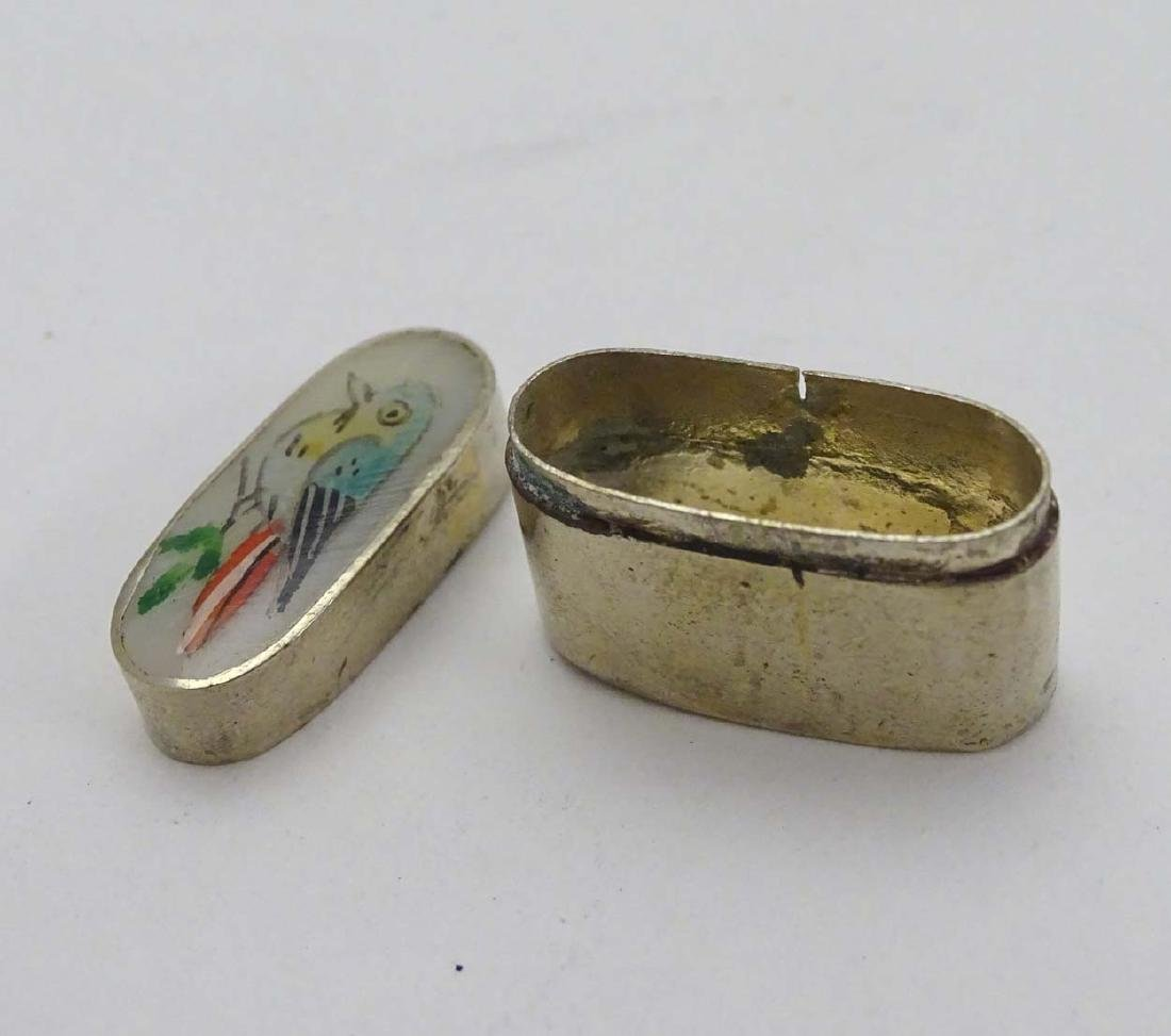 A silver plate small pill box of ovoid form with image - 4