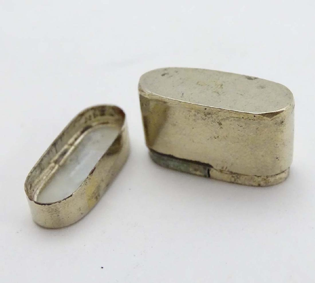 A silver plate small pill box of ovoid form with image - 5