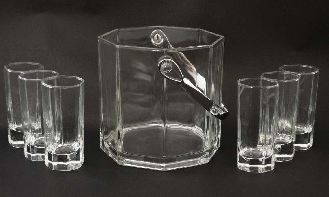 An octagonal glass ice bucket together with 6 octagonal