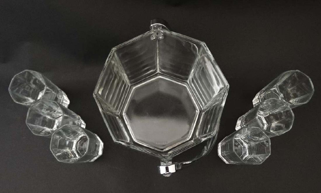 An octagonal glass ice bucket together with 6 octagonal - 3