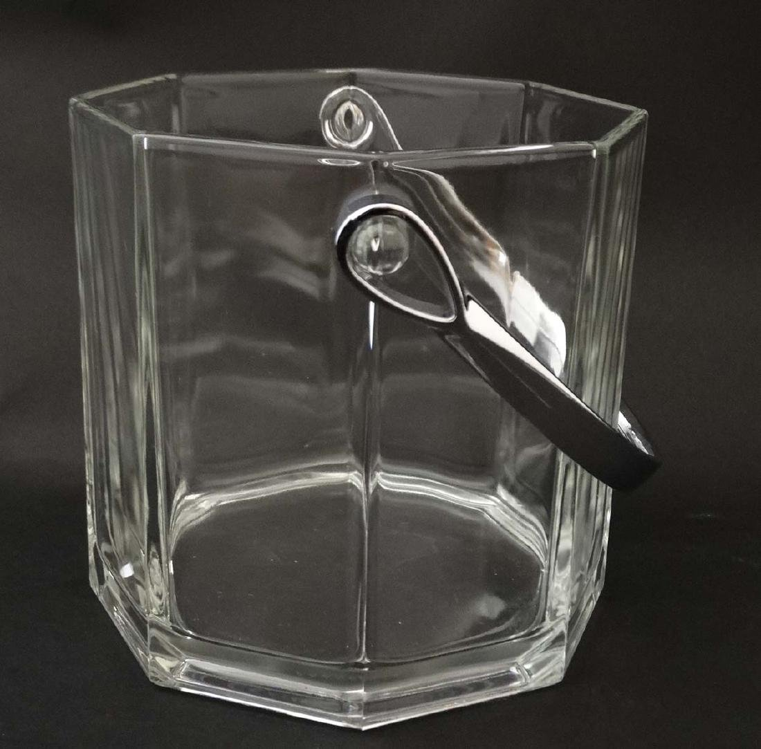 An octagonal glass ice bucket together with 6 octagonal - 4
