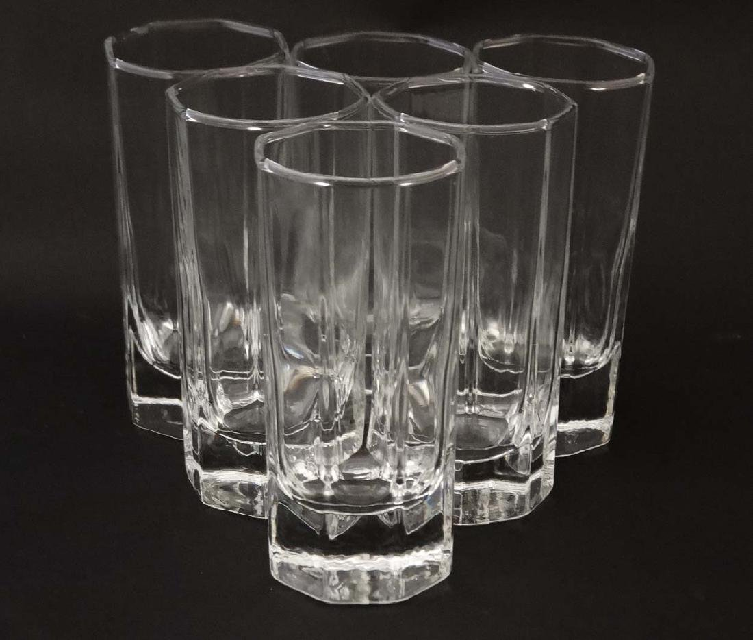 An octagonal glass ice bucket together with 6 octagonal - 6