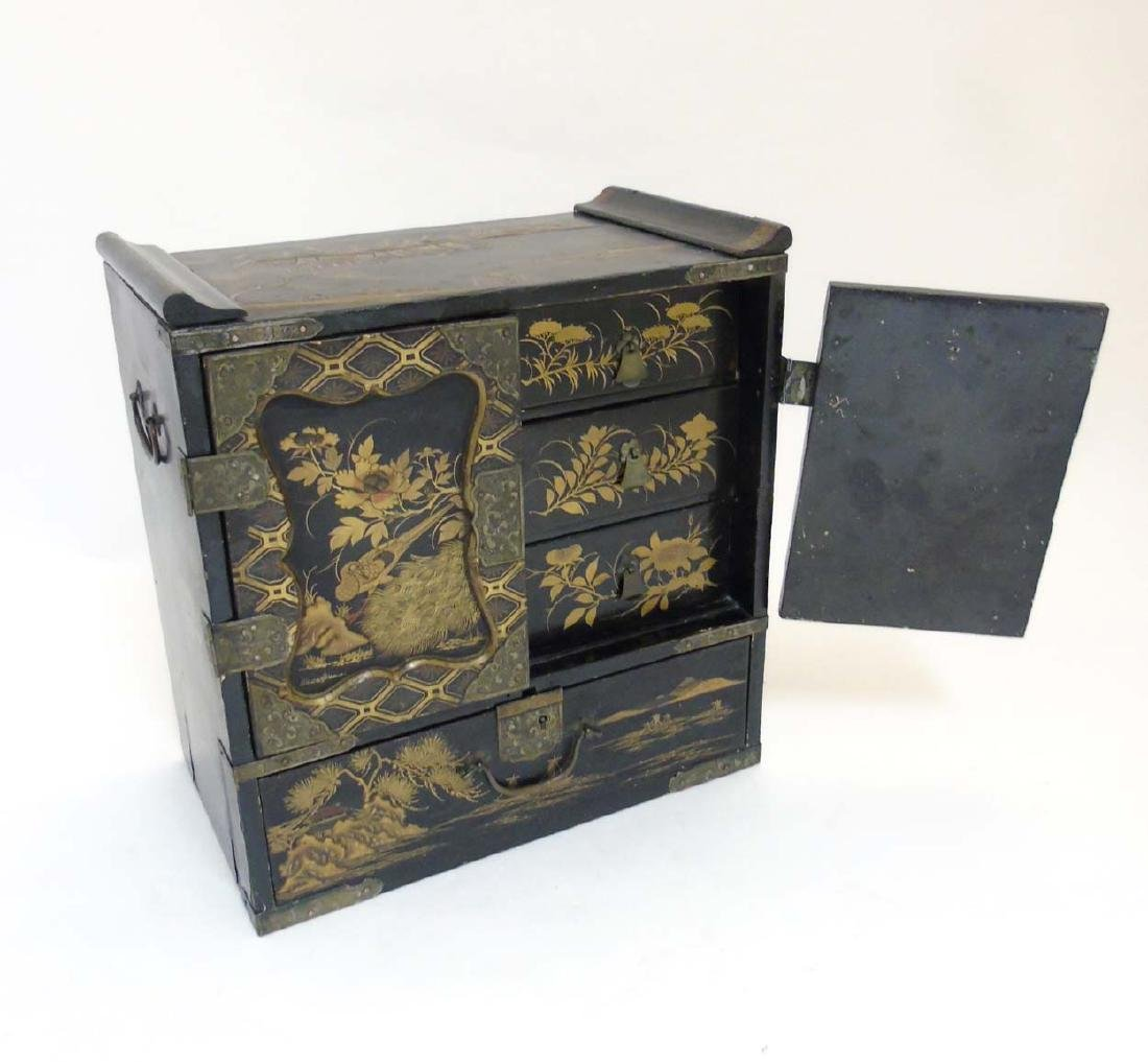 An Ornate Japanese table cabinet opening to reveal - 3
