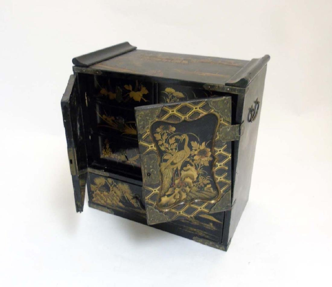 An Ornate Japanese table cabinet opening to reveal - 4