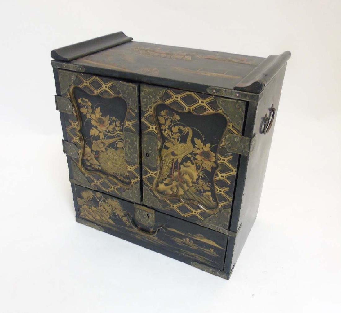 An Ornate Japanese table cabinet opening to reveal - 6