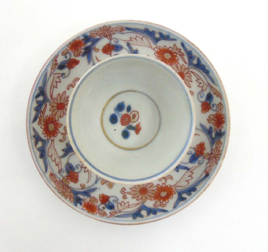 A Japanese Imari cup and saucer, decorated in blue - 2