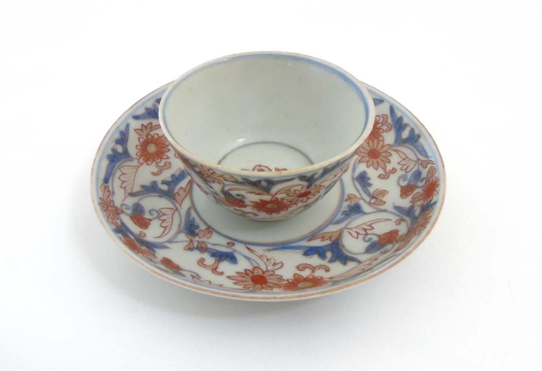 A Japanese Imari cup and saucer, decorated in blue - 3