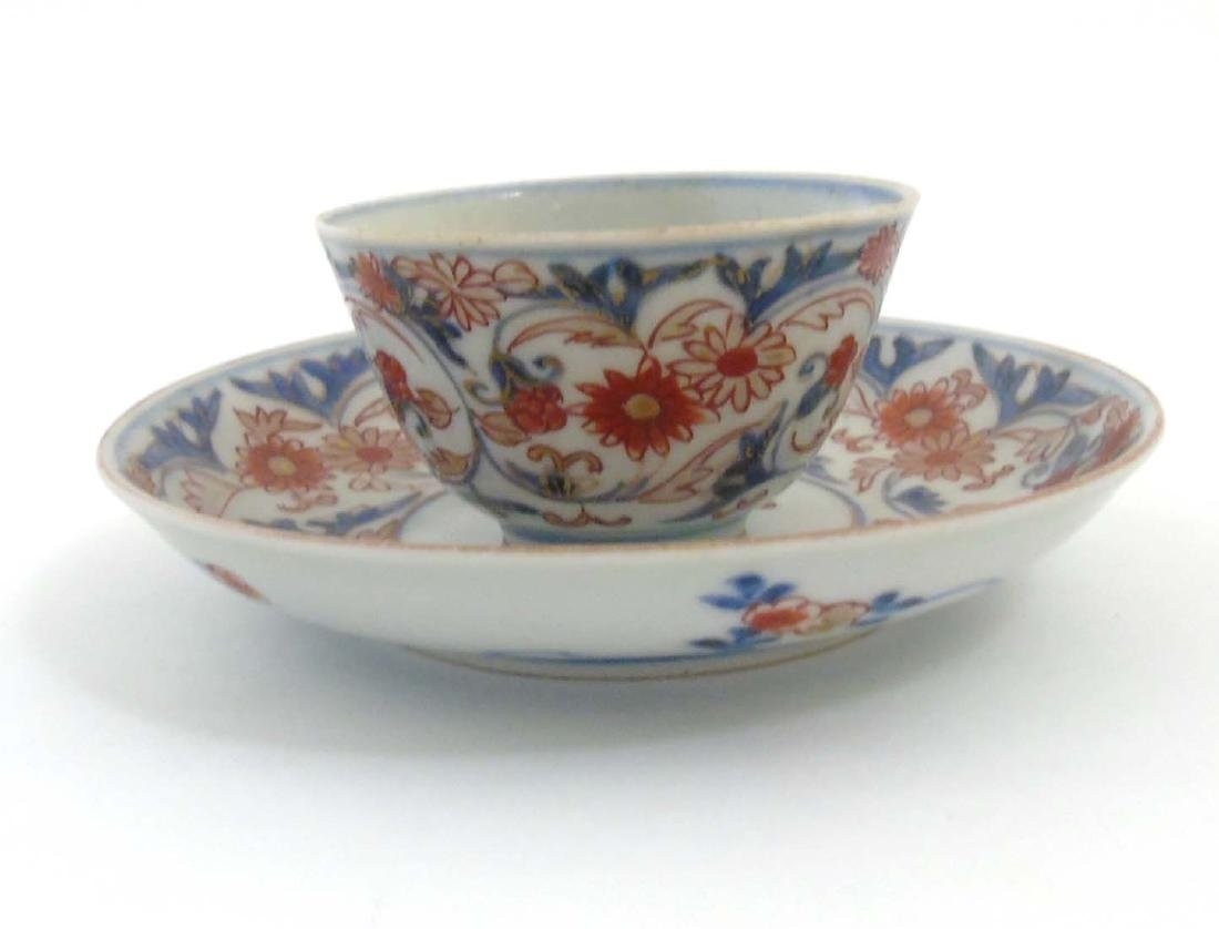 A Japanese Imari cup and saucer, decorated in blue - 4