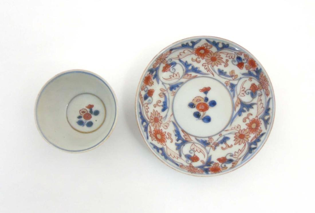 A Japanese Imari cup and saucer, decorated in blue - 5