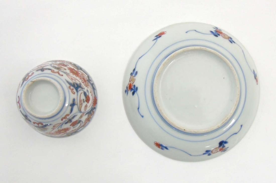 A Japanese Imari cup and saucer, decorated in blue - 6
