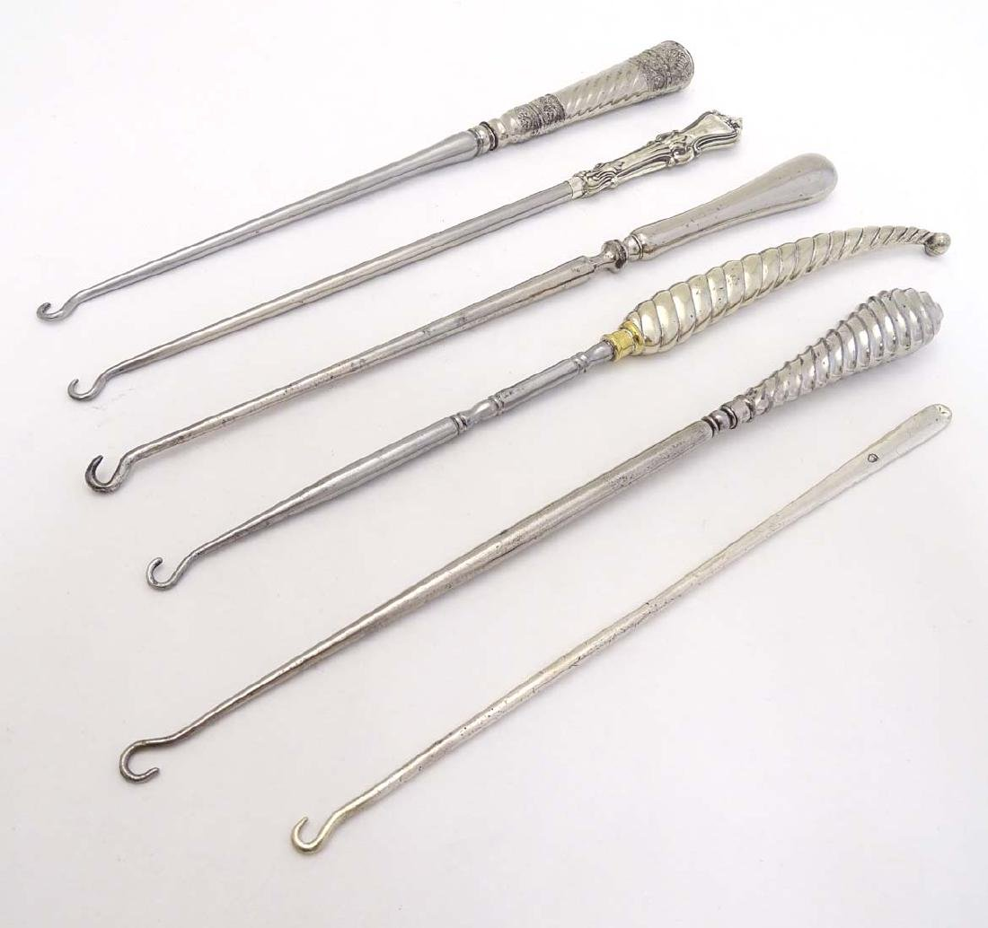 6 assorted button hooks with silver plate handles . The - 7