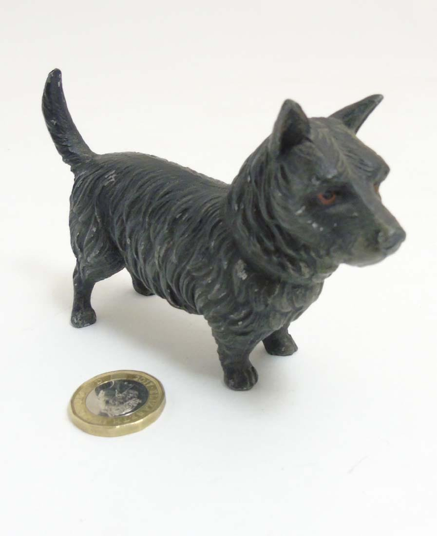 A Victorian cold painted base metal model of a terrier